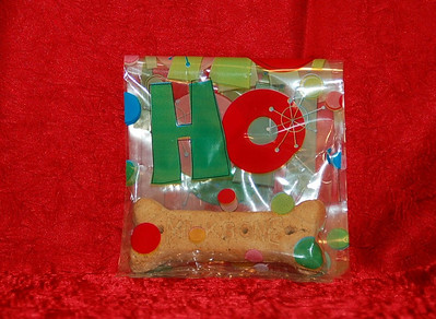 Free Puppy Treat Samples in Christmas themed cello bag.