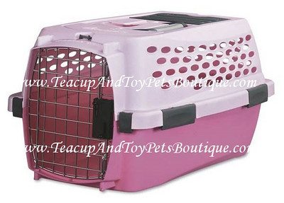 Pet Mate Travel Carrier is airline approved. Color: Pink