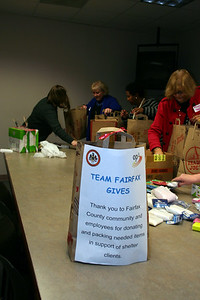 Fairfax County Employees using their volunteer leave packed 77 bags of needed personal items for the Embry Rucker Shelter.