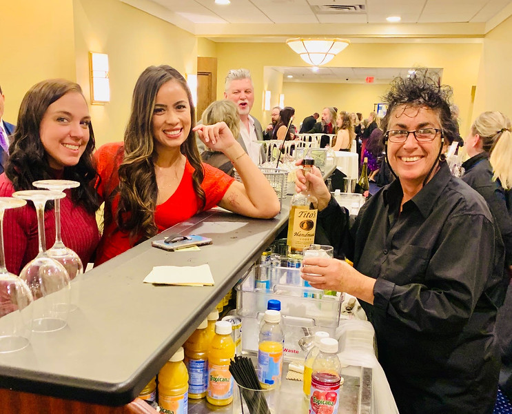 From left, Bianca Arsenault of Haverhill and Maya Johnson of Chelmsford keep bartender Angela Sarantakis of Lowell busy.