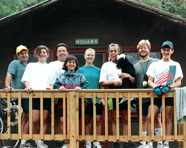 The first morning after the rain, the Quincy Hospital Bike Team bonds with Cabin Mates in the Mohawk Cabin Camp Burgess Sept 1994. L-R - Doug Haskins, Chris Garrett, Ed Lapanus, Laura Mirabella, Linda Swanson, Jamie Jensen her 3yo son, Tim Cooney and Matthew who was 15 and a neighbor of Jamie.