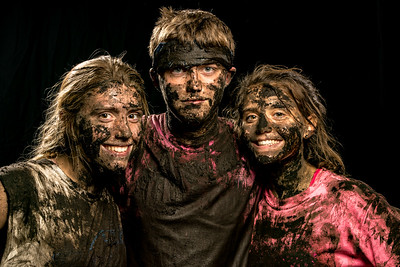 Dirty Childs:  Erin, Liam and Ashley Childs pose for a family photo after the Oxford Hills' cross country team's annual Moody Bloody event held at a non-disclosed location.