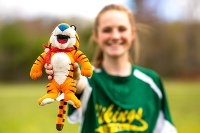 Viking Tiger: Briana Casey hold up the team mascot after the group photo.