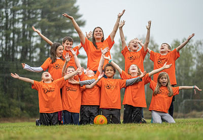 Singin' in the Rain: A little downpour puts no dent in the spirit of the Norway Cobras.