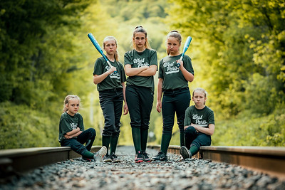 On Track: Gracie Cooper, Emma Cooper, Michelle Henderson, Mya Buck, Brooklynn Henley pose on the rails behind the West Paris fields.