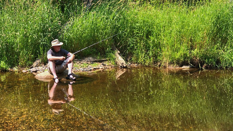 Yours truly fishing for and catching (and releasing) Rainbow Trout.