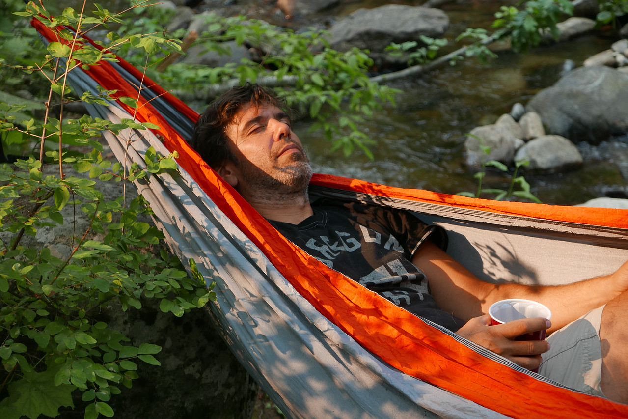 Joe taking a break by the stream after a long day out in the heat.