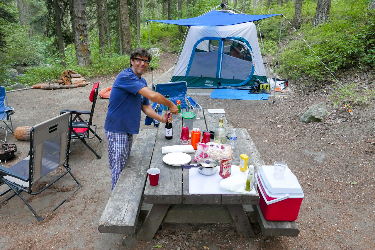Dinner time at camp.  Bacon wrapped Filet Mignon, sautéed mushrooms and onions, fresh grilled corn-on-the-cob, a couple of bottles of Pinot Noir and for dessert Vanilla Ice Cream and fresh sliced peaches in a honey and cinnamon glaze.  Yep, we eat well when we camp.