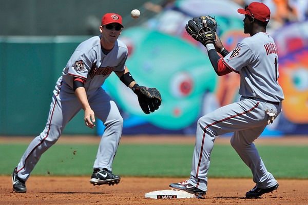 16 April 2008:  Stephen Drew tosses a double play ground ball to Orlando Hudson in the second inning during the Arizona Diamondbacks' 4-1 victory over the San Francisco Giants at AT&T Park in San Francisco, CA.