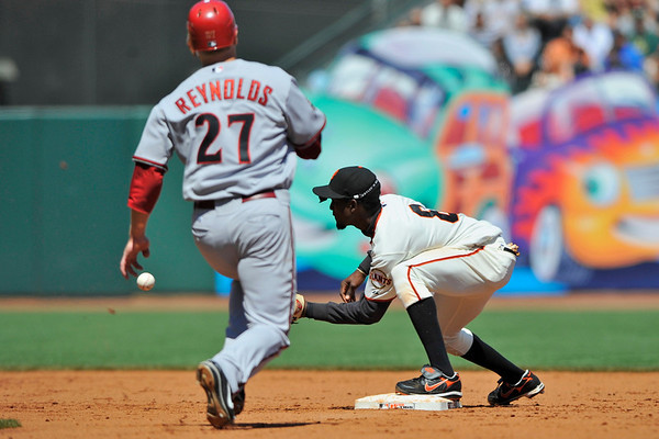 16 April 2008:  Mark Reynolds heads to second base as the ball arrives to Eugenio Velez during the Arizona Diamondbacks' 4-1 victory over the San Francisco Giants at AT&T Park in San Francisco, CA.