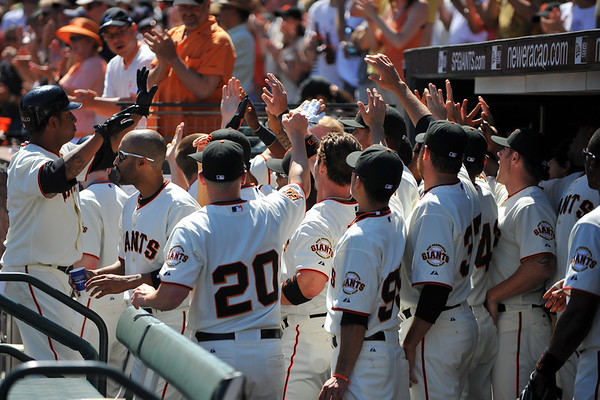 12 April 2008:  Jose Castillo (12) celebrates with teammates after the Giants took an early 5-0 lead during the St. Louis Cardinals' 8-7, 10-inning, victory over the San Francisco Giants at AT&T Park in San Francisco, CA.
