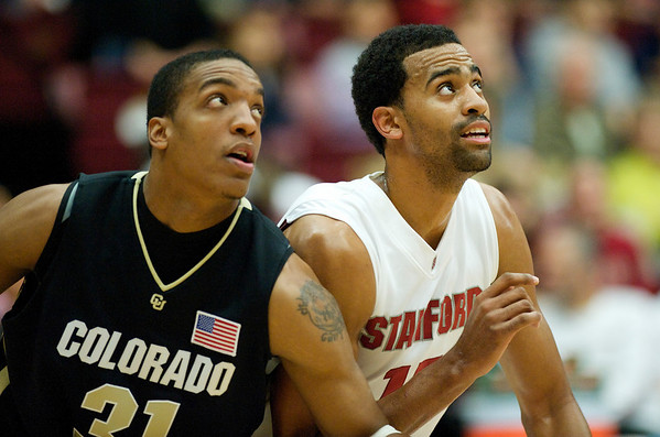 29 November 2008:  Stanford forward Lawrence Hill (15) and Colorado forward Jermyl Jackson-Wilson (31) battle for position during the first half of the Stanford Cardinal's 76-62 win over the Colorado Buffaloes at Maples Pavilion in Stanford, California.