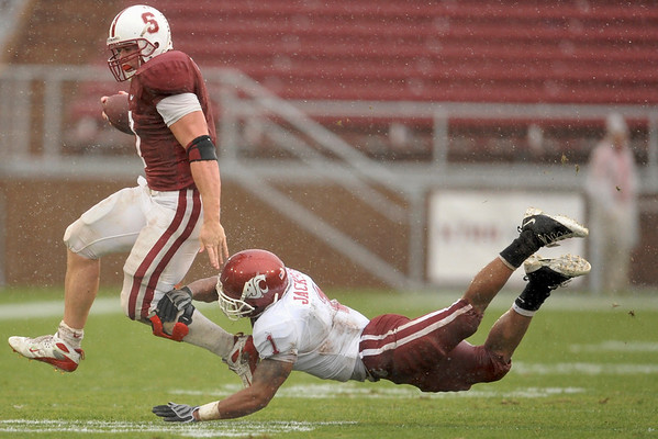 01 November 2008: Stanford running back Toby Gerhart (7) breaks a tackle by Washington State defensive back Alfonso Jackson (1) during the Cardinal's 58-0 victory over the Cougars at Stanford Stadium in Stanford, CA.  Gerhart rushed for 132 yards and scored four touchdowns.