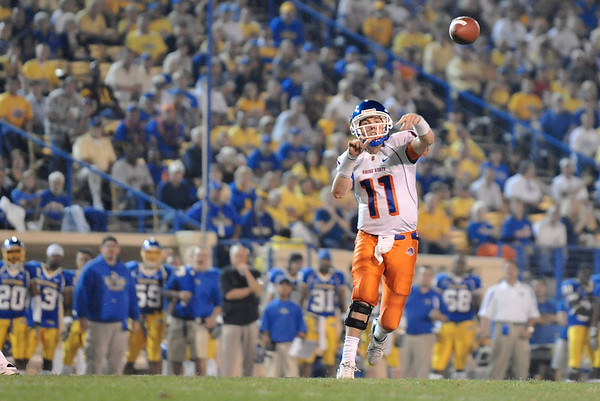 Oct. 24, 2008; San Jose, CA, USA; Boise State quarterback Kellen Moore (11) throws a touchdown pass into the end zone during the second quarter of the Broncos 33-16 victory over the San Jose Spartans at Spartan Stadium in San Jose, CA. Mandatory Credit: Daniel R. Harris-US PRESSWIRE