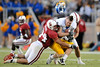 20 September 2008: Stanford linebacker Pat Maynor (44) and safety Bo McNally (22) sandwich San Jose State wide receiver Jeff Clark (9) who loses his helmet during the Cardinal's 23-10 victory over the the Spartans at Stanford Stadium in Stanford, CA.