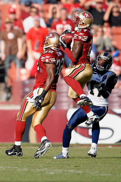 Nov. 16, 2008; San Francisco, CA, USA; San Francisco 49ers cornerback Walt Harris (27) intercepts a pass in front of St. Louis Rams wide receiver Donnie Avery (17) during the second quarter of the 49ers game against the Rams at Candlestick Park. Mandatory Credit: Daniel R. Harris-US PRESSWIRE