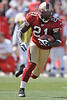 Sep. 21, 2008; San Francisco, CA, USA; San Francisco 49ers running back Frank Gore (21) runs into the secondary during the second quarter of the 49ers 31-13 victory over the Detroit Lions at Monster Park in San Francisco, CA. Mandatory Credit: Daniel R. Harris-US PRESSWIRE