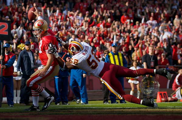 Dec. 28, 2008; San Francisco, CA, USA; San Francisco 49ers quarterback Shaun Hill (13) scores a touchdown as Washington Redskins linebacker Rocky McIntosh (52) dives for the tackle in the first quarter of the 49ers game against the Redskins at Candlestick Park. Mandatory Credit: Daniel R. Harris-US PRESSWIRE