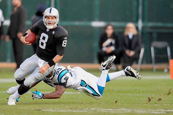 Nov. 9, 2008; Oakland, CA, USA; Oakland Raiders quarterback Marques Tuiasosopo (8) scrambles as Carolina Panthers linebacker Na'il Diggs (53) dives for the tackle during the fourth quarter of the Panthers 17-6 victory over the Raiders at Oakland-Alameda County Coliseum. Mandatory Credit: Daniel R. Harris-US PRESSWIRE