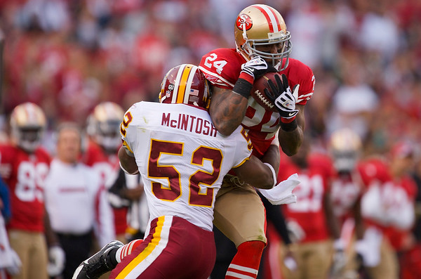 Dec. 28, 2008; San Francisco, CA, USA; San Francisco 49ers running back Michael Robinson (24) makes a leaping catch over Washington Redskins linebacker Rocky McIntosh (52) in the fourth quarter of the 49ers 27-24 victory over the Redskins at Candlestick Park. Mandatory Credit: Daniel R. Harris-US PRESSWIRE