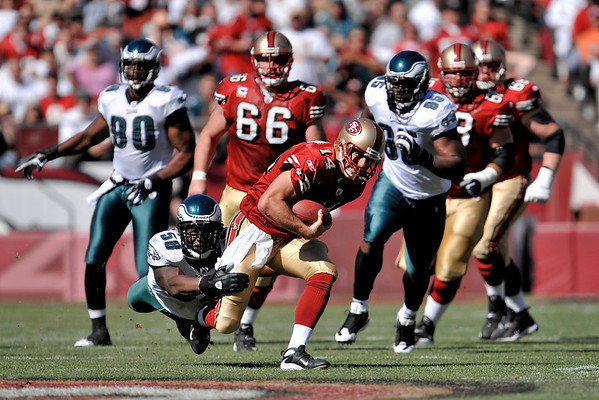 Oct. 12, 2008; San Francisco, CA, USA; San Francisco 49ers quarterback J.T. O'Sullivan (14) scrambles for a first down as Philadelphia Eagles defensive end Trent Cole (58) makes the diving tackle in the second quarter of the 49ers game against the Eagles at Monster Park in San Francisco, CA. Mandatory Credit: Daniel R. Harris-US PRESSWIRE