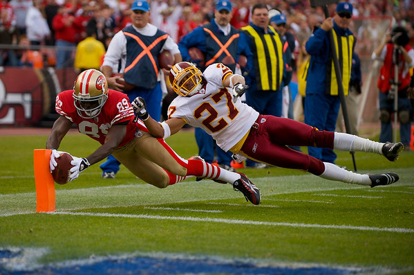 Dec. 28, 2008; San Francisco, CA, USA; San Francisco 49ers wide receiver Jason Hill (89) makes a catch and dives into the end zone for a touchdown as Washington Redskins cornerback Fred Smoot (27) tries to make the stop in the fourth quarter of the 49ers 27-24 victory over the Redskins at Candlestick Park. Mandatory Credit: Daniel R. Harris-US PRESSWIRE
