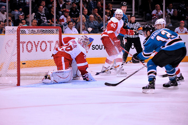 30 October 2008: San Jose Sharks center Patrick Marleau (12) shoots the puck past Detroit Red Wings goalie Ty Conklin (29) to score the Sharks' first goal during the second period of the Sharks 4-2 win over the Red Wings at HP Pavilion in San Jose, California.  **** Editorial Usage Only *****