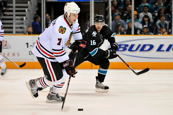 26 November 2008:  San Jose Sharks right wing Devin Setoguchi (16) challenges Chicago Blackhawks defenseman Brent Seabrook (7) for the puck during the second period of the Sharks game against the Blackhawks at HP Pavillion in San Jose, California.  **** Editorial Usage Only *****