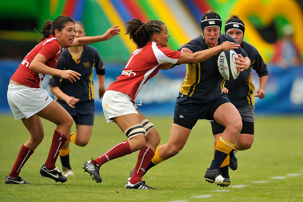 02 May 2008:  Kelsey Moss moves in on the ball during Stanford's 40-20 victory over Navy in the NCAA Division I Women's Rugby National Semi-Final match at Stueber Rugby Stadium in Stanford, CA.