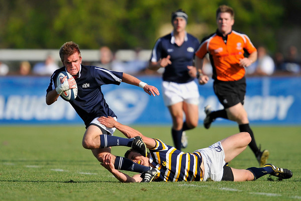 02 May 2008:  Dustin Muhn (striped) tries to make a tackle on Shaun Michael Davies (with the ball) during California's 59-7 victory over BYU in the Collegiate Division I Men's Rugby National Final match at Stanford University's Stueber Rugby Stadium in Stanford, CA.  The California win represents its fifth straight national rugby championship.