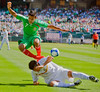 05 July 2009:  Nicaragua defender Carlos Alonzo (5) tackles the ball as Mexico forward Alberto Medina (7) leaps over him during the Group C match of the Confederation of North, Central America and Caribbean Association Football Gold Cup at the Oakland-Alameda County Coliseum in Oakland, California.  Mexico defeated Nicaragua 2-0.