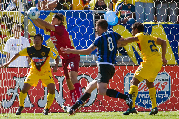 19 July 2009:  Club America goalkeeper Armando Navarrete (12) blocks a shot in front of defender Guillermo Cerda (15) and Inter Milan midfielder Thiago Motta (8) during play in the World Football Challenge match between Club America and Inter Milan at Stanford Stadium in Stanford, California.  Club America prevailed 1-1 on penalty kicks.