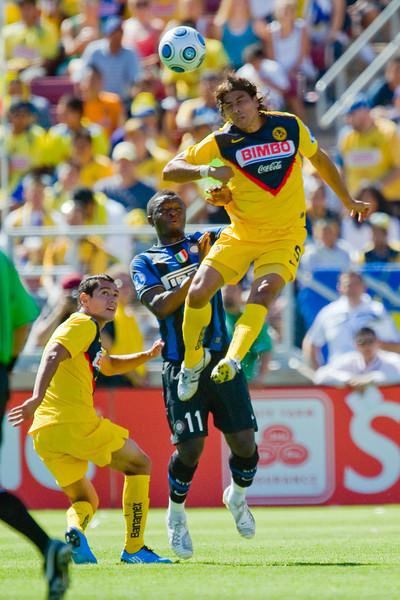 19 July 2009:  Club America defender Ricardo Rojas (5) leaps for a header over Inter Milan midfielder Sulley Ali Muntari (11) during play in the World Football Challenge match between Club America and Inter Milan at Stanford Stadium in Stanford, California.  Club America prevailed 1-1 on penalty kicks.