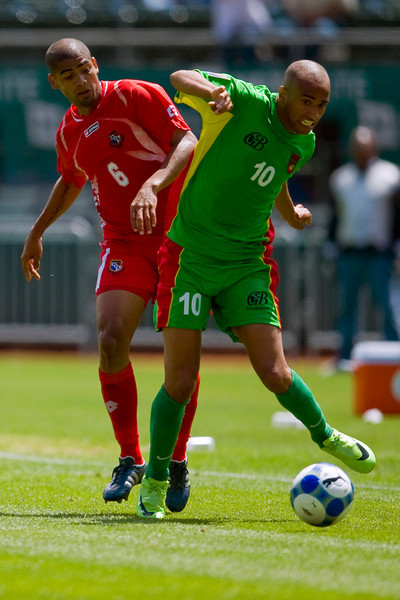 05 July 2009:  Guadeloupe midfielder Aurelien Capoue (10) dribbles in front of Panama midfielder Gabriel Gomez (6) during the Group C match of the Confederation of North, Central America and Caribbean Association Football Gold Cup at the Oakland-Alameda County Coliseum in Oakland, California.  Guadeloupe defeated Panama 2-1.