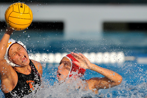 10 May 2008:  Stanford Cardinal Jacquelyn Gauthier (3) defends Veronika Bartunkova (4) during the semi-final match of the 2008 NCAA women's water polo championships at the Avery Aquatic Center in Stanford, CA.  USC defeated Stanford 10-6, to move on to the championship match against UCLA.