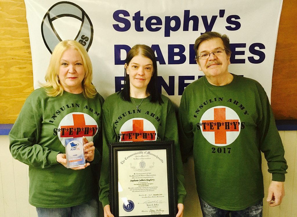 . Chairwoman Stephy Culbert-Clougherty, center, with her parents, Konni Stys of Nashua, N.H., and Joe Culbert of Lowell.