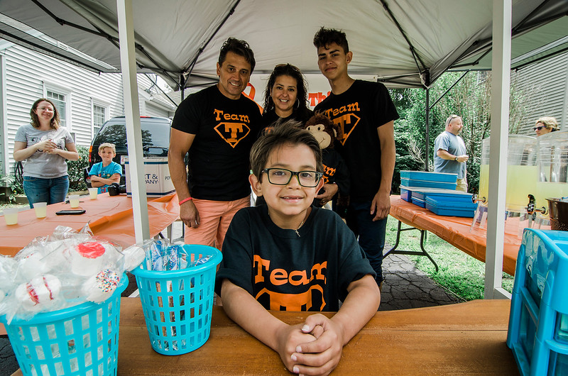 The Molinari Family, of Fitchburg, raised money for the Lucy's Love Bus on Saturday, July 29, 2017 with a lemonade stand on Hancock Street. Six-year-old Thiago Molinari just recently finished treatment for Leukemia. Lucy's Love Bus is an organization that delivers helpful integrative therapies, comfort and quality of life to children with cancer. Pictured are dad Nestor, mom Gabriella, brother Nico and 6-year-old Thiago. SENTINEL & ENTERPRISE / Ashley Green