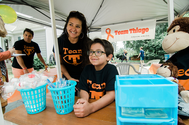 The Molinari Family, of Fitchburg, raised money for the Lucy's Love Bus on Saturday, July 29, 2017 with a lemonade stand on Hancock Street. Six-year-old Thiago Molinari just recently finished treatment for Leukemia. Lucy's Love Bus is an organization that delivers helpful integrative therapies, comfort and quality of life to children with cancer. Gabriella Molinari and Thiago talk with customers. SENTINEL & ENTERPRISE / Ashley Green