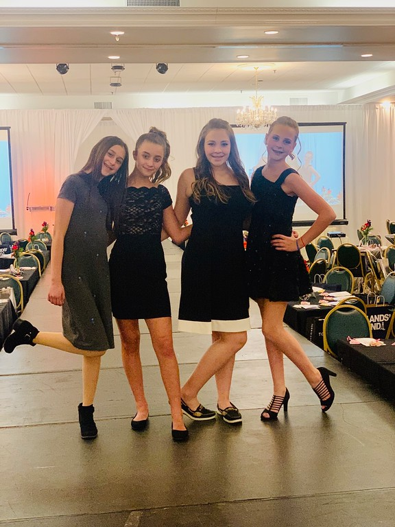 . Young fashionable models, from left, Kathryn Portante of Westford, Danielle Orr-Skirvin of Nashua, Maddie Klyop of Londonderry, N.H., and Carissa Schutt of Westford