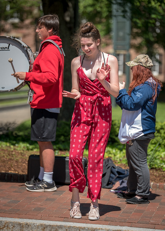 . Hannah Kimball, a rising sophomore at Dracut High School and in the colorguard, dances with the Dracut High School band. Kimball\'s grandmother fought breatst cancer. Behind her are Conor Slattery, left, and Maddie LeMarche.  The band supported the CancerCare walkers in Lowell on Sunday.  SUN/Scot Langdon