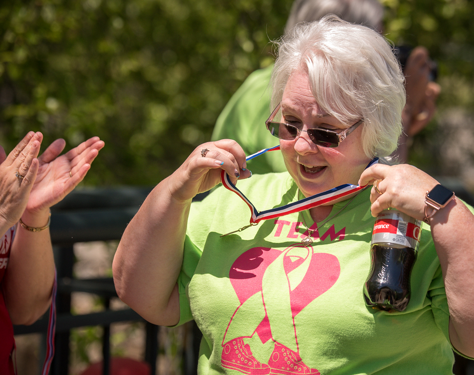 . Cindy Michaels of Lowell receives her survivor\'sd medal at the finish line.    The walk was part of the 19th Annual Lowell General Hospital Teamwalk for CancerCare hosted on the grounds near the Tsongas Center in Lowell Sunday.   SUN/Scot Langdon