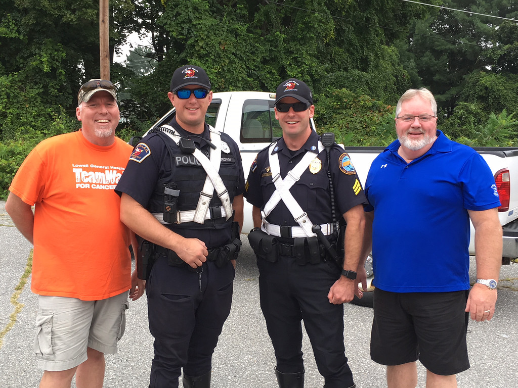 . From left, Jim Boyd, Chelmsford police Officer Bob Brown and Sgt. Jason Poor, all of Chelmsford, and Jay Kiernan of Lowell