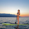 WOMAN ON STAND UP PADDLE BOARD, MAUI, HAWAII.
