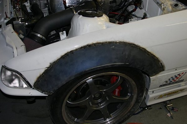 """The """"flare"""" section from an OEM E46 M3 front fender grafted to an E36."""