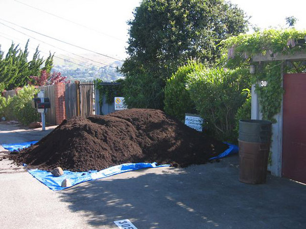 Bulk organic compost is delivered for a landscaping and vineyard project.