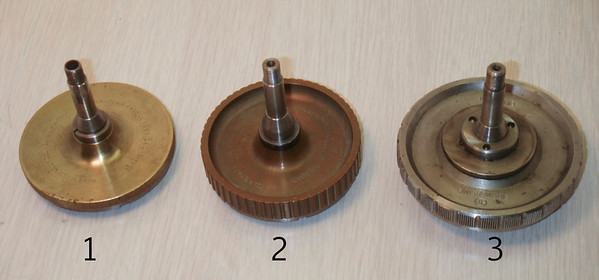 "Figure 4 – The Backs of Three Styles of 6-Jaw Chucks – Numbers reflect chucks in Figure 3<br /> <br /> The first two chucks in Figure 4 were made by the American Watch Tool Company, in Waltham Mass.  They are labeled ""SNYDER'S PATS. JUNE 28 . DEC . 13 – 1881"" (see Figure 5).  While extremely collectible, these chucks typically have too shallow of jaw steps to be used for holding clock gears."