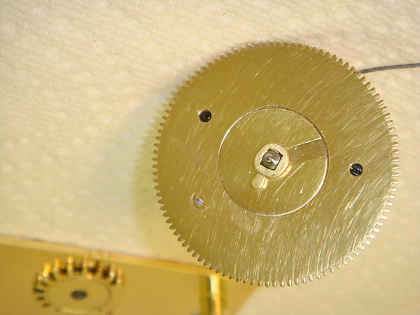 Here is the single leaf gear of the Geneva stop mechanism on the square on the winding arbor.