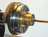 Figure 5 – Winding drum held in a 6-jaw chuck<br /> <br /> In a similar manner, I chuck up the drum itself in a 3-jaw chuck to work the pivots on the other end of the arbor.  Figure 6 shows such a set-up.