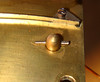 Figure 2 - Taper pin holding a front mechanism plate to a post<br /> <br /> When I am disassembling a mechanism I check to see how easy it is to slip the plate back onto the posts holding the mechanism together.  It is common to have some friction – due to the pillars not quite lining up, but it is also common to find that a pillar doesn't want to go into a plate hole, usually because of damage either to the pillar or the hole.