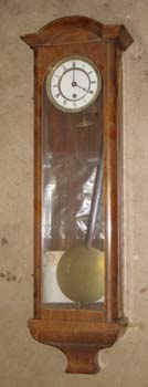 "Vienna Regulator Clock No 346 before restoring the headpiece.<br /> Often when found, antiques show more ""age"" than we might want, a chip of veneer missing here, a bit of stringing lost there, some finish removed when someone taped the pendulum to the back of the case... Or, as the buyer of number 346 put it, ""The clock does look a little forlorn. I am glad you can envision the final product. I don't have enough experience to be able to tell it's potential."" <br /> <br /> Yes, this piece (measuring only 25 inches long) offered massive potential, but wanted a lot of love to realize it."